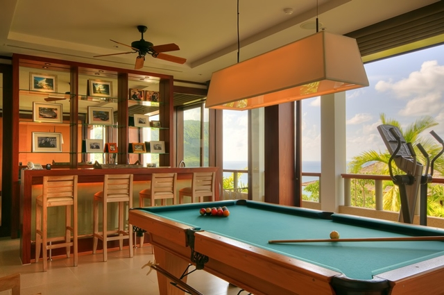 Room with pool table and bar
