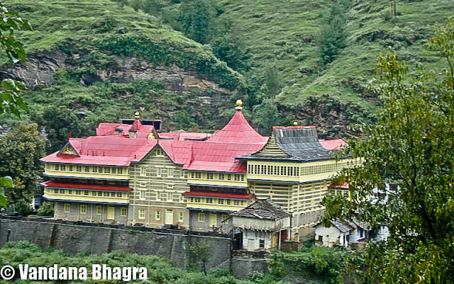 "An architectural marvel: Jubbal Palace : By Shimla, Vandana Bhagra : Photo credits: Given by the owners : When we use the phrase ""har ghar kuchh kehta hai"", a novel concept adopted by the Himachal government in promoting heritage properties of Shimla town, we often associate them with the Britisher's rule, rich in history with facts, photographs and antiques dating back to that period. And when we talk about royalty we are equally impressed by the grandeur and imperial finesse with which they once lived in or are still living. One such architectural marvel is the Jubbal Palace, residence of HH Raja Rana Yogendra Chandra and Rani Sudha Kumari, about 92 kms from Shimla taking approximately four hours to reach via Theog, Kotkhai and Khara Patther. The setting is just picture perfect, with River Bishkalti on one side and the Kuper peak as the backdrop. Once described in the Imperial Gazetteer of India as being ""built in partially Chinese style, the lower portion consisting of masonry, while the upper half is rined round with wooden galleries capped by overhanging eaves. The Palace is remarkable for the enormous masses of deodar timber used in its construction"". Rightly said, as when you walk through the Durbar Hall or the Indian style baithak your steps are arrested by the massive paneling work done on the ceilings, the intricate woodwork, carved bordered facades, Persian carpets and antiques all around the rooms are enough to give you a royal feel. The Durbar Hall has these carved jharokhas on the upper floor, then used by women to watch the proceedings below or the royal functions which were held during those days, were initially built by a women craftsmen from Chaupal and even till date they remain as pristine as ever. As royalty would have it, there were different drawing rooms for both men and women and as Raja Yogendra Chandra adds, ""even Raja and Rni had separate bedrooms connected with a spiral staircase"". Family heirlooms which can be seen are quivers and arrows, family portraits, pieces of art and ivory ilaid peacock chairs. The stunning display of ancient artilleries ranging from cannons, swords to muskets and shield will just tickle your senses and give you a feeling of being a warrior. The fireplaces add an old charm to the Palace which has a collection of Kangra paintings on the Radha Krishna theme hung over them.  The old structure was brought down in 1935 and what stands now is a mix of Gothic, Art Deco and local architecture. An interesting anecdote Sudha Kumari states ""It was decided that a new Capital would be built for administrative purposes, which would have a new Palace, a tehsil, a prison and an armoury and Old Jubbal would only be used for religious functions and on these grounds a pujan was performed during which as a ritual a chicken was sacrificed. The place where this chicken would land would be earmarked as the new location of the Palace. The bird landed on a small hill formerly known as Deora, now Jubbal, where construction began"". Despite the fact that a French architect was hired to dothe initial structure but Rani Sudha, soon after marriage in 1960, involved herself with the construction of the Palace and personally saw to it that the esthetics of the place was maintained. The modern wing of the Palace exhibits an inquisitive blend of Indo and European styles. Even after the Sheesh Mahal and three other buildings in the Palace complex were burnt down on 29th October 1969, she ensured that same style was adopted while reconstructing the building. The Sheesh Mahal was adorned with large framed mirrors with all modern facilities, the construction of which was started by Raja Sir Bhagat Chandra of Jubbal in 1911 and was completed in 1918.  Whereas the present Palace was built by his son Raja Digvijai Chandra and the construction was started in 1935. Raja Yogendra Chandra, adds ""construction of buildings, prior to the making of Sheeh Mahal during those days, was done without using any iron nails as only wooden pegs were used to hold thestructure. Layers were made of stone and wooden beams whih held the structure firmly and resistant to earthquakes or tremors. While undertaking construction of the new sections these concepts were kept in mind"". The entrance of the Palace opens into the central courtyard where a temple stands tall with a Pagoda style roof and a unique feature as lead has been used in its construction. Nestled behind the temple tower is the oldest wing of the Palace built in Pahari-style with alternate courses of dressed stone and wooden beams. There are numerous numbers of bedrooms with attached bathrooms, built around the courtyard, furnished with Persian carpets, amazing accessories and beautifully carved furniture. The umpteen number of artifacts and family treasures discovered in the old wing of the Palace have been restored and displayed all over the Palace by Sudha, who spends nearly four months in a year at Jubbal.  Rani Sudha says, ""a section of the property was opened to guests but since the courtyard was common and our private quarters were in the same area we felt that ur privacy was being disturbed. In spite of the fact that we were overbooked, we decided to close the property for guests just after a month. Communication too was a huge problem due to bad road conditions"". Admiringly Yogendra Chandra says, that the upkeep and maintenance of the Palace is credited to my wife and son who look after the place as its fresh paintwork, polished woodwork round the clock, sparkling windowpanes and glistering balconies are a thing to fathom. The upcoming library section is a welcome addition to their Palace as it holds a treasure of books collected over a period of time. Rani Sudha reminisces and ends on a note on how Jubbal earned its name, ""one day a person was seen digging and planting seeds, and second day a joob (evergreen grass) came up, or dhub, used on auspicious occasions, and he called it as a good omen saying that there would be everlasting greenery and prosperity, and the Raja, who was then staying in Raika, near Hatkoti, should build his Palace here. Hence, this place arned its name as Jubbal""."