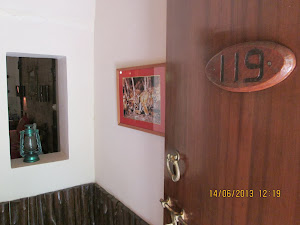 """Room No 119"" our palatial accomodation designed in rustic  fashion with ""Tiger Photographs"" ."