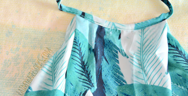 Close-up on the blue-green floral leaf print on WalkTrendy's two-piece summer beach set.