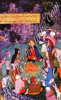 Babur and Companions Warming Themseles befour a Camp Fire