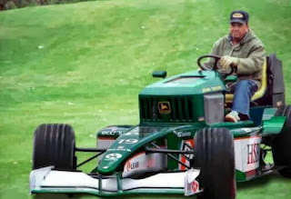 funny picture: grandfather Formula 1 lawnmower