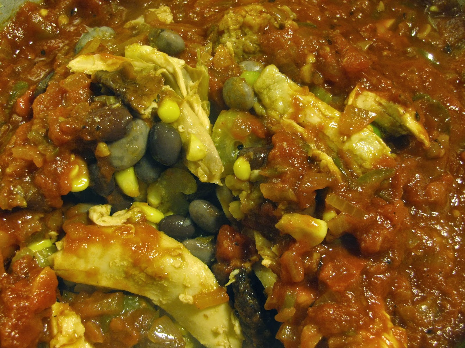 shredded chicken, beans, corn, celery, tomato sauce coming together for a chicken chili