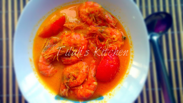 Prawns cooked in the traditional malay style using coconut milk and red chillies