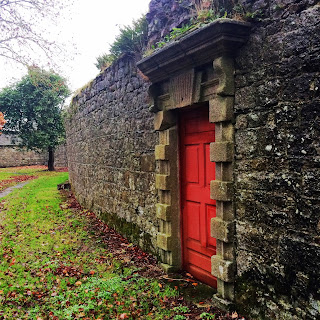 Red door in wall, Duckett's Grove Castle