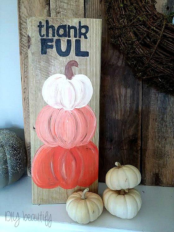 painted pumpkin topiary sign at diy beautify