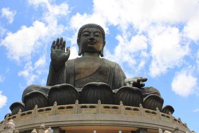 An upclose of Big Buddha statue (Tian Tan Buddha) after reaching to the top of the mountain of Po Lin Monastery at Ngong Ping Village in Hong Kong