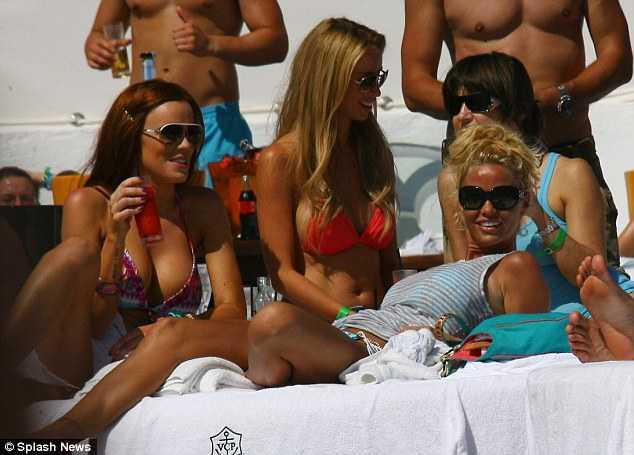 Katie Price enjoys some girls talk with fellow glamour models Maria Fowler ...