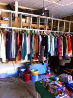 The Blue Spotted Owl: Garage Sale! How To Hang Clothes At A Garage Sale on homemade round clothes rack for garage sale, ghetto garage sale, yard sale, ideas for garage to hang clothes on sale,