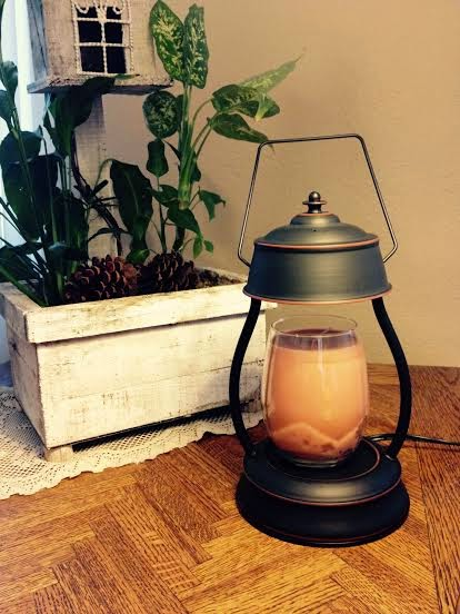 i have the candle warmer lantern pictured above and it is so stinking cute
