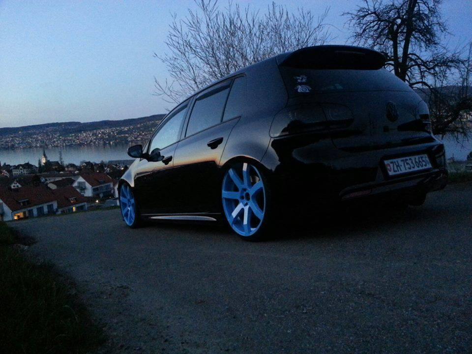 Volkswagen Golf MK6 In Black Color Dropped And Colorful Alloy Rims This Car Have Smoke Headlights Rear Lights