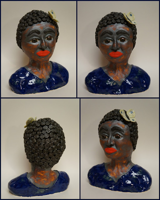 Beautiful ceramic pottery sculpture of a negro woman.