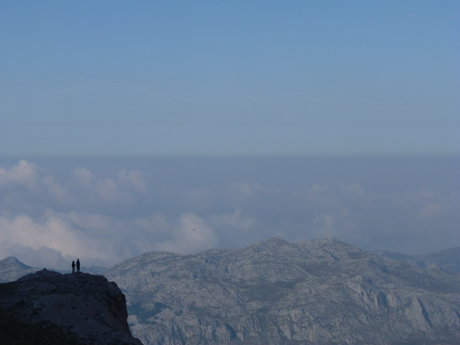 two figures look out over cloud inversion