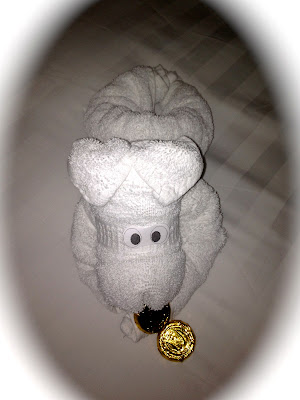 Puppy towel animal with gold chocolate coins