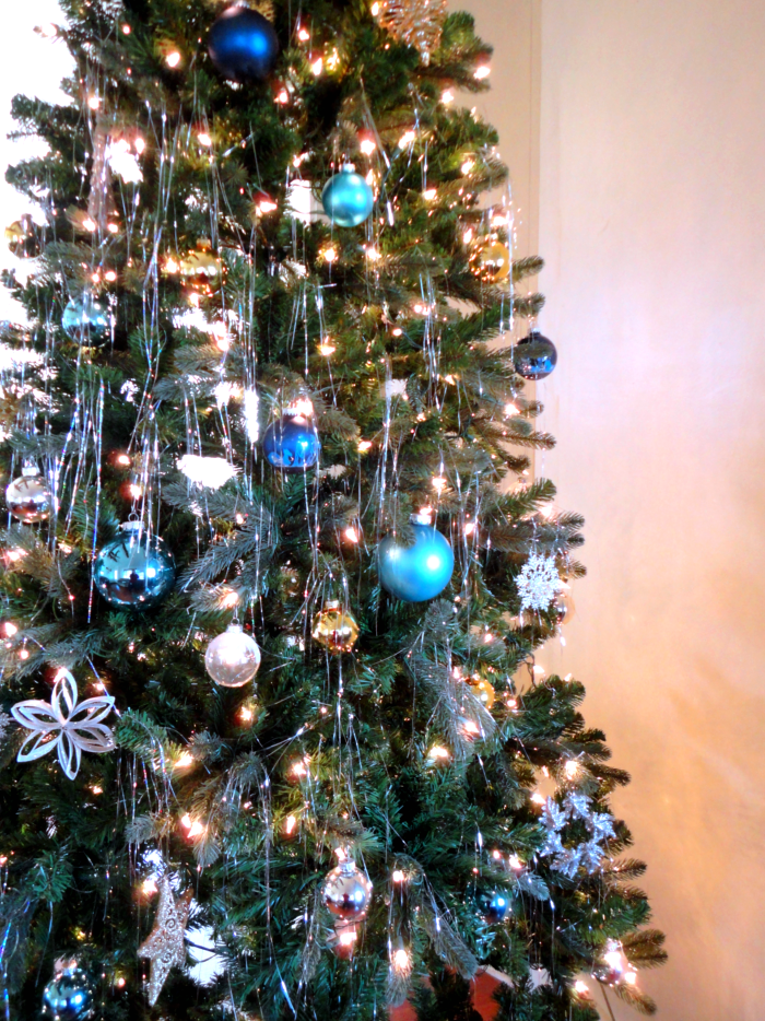 Gold and blue christmas tree and silver on the tree