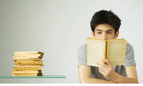 Boy reading books without titles