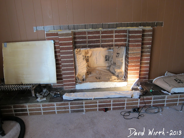 put insulation in fireplace to save heat