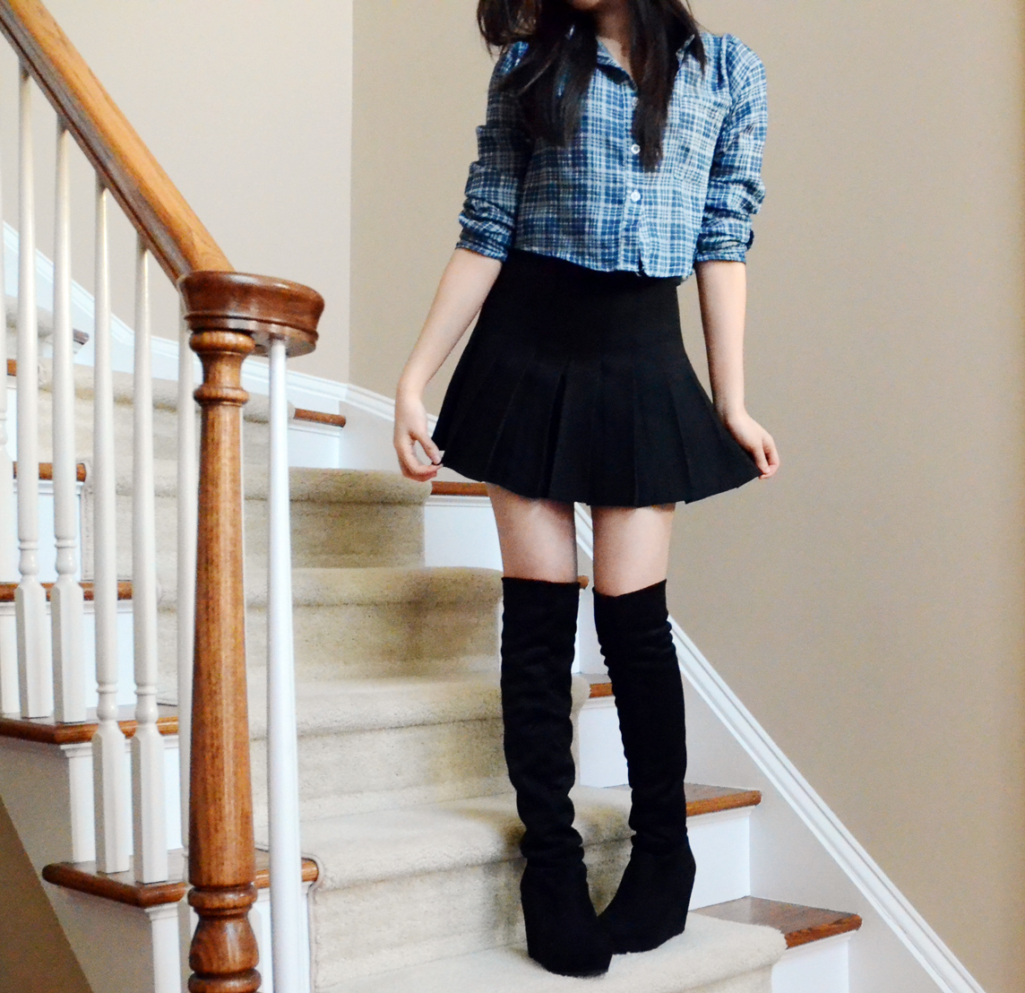 Full view of the SheInside pleated skirt (American Apparel dupe) as well as the plaid cropped shirt and wedged knee-high boots.