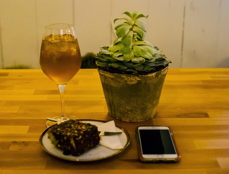 picture of banana cake and elderflower tea in cafe basement