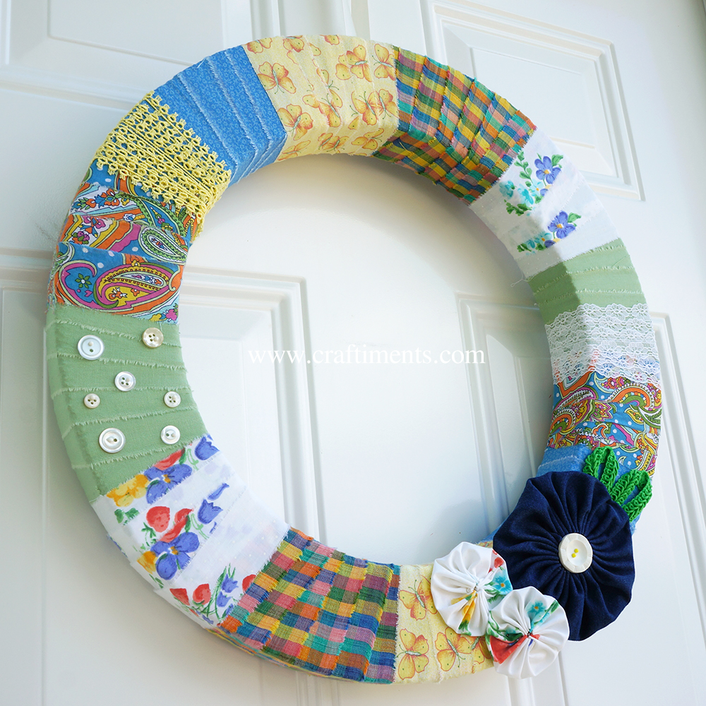 Styrofoam wreath wrapped with strips of torn fabric, lace and trim