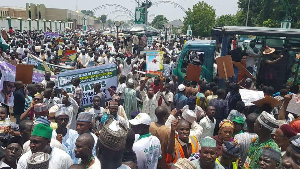 Drama as Buhari's supporters clash at Abuja rally