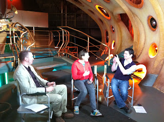 Simon Guerrier, Josie Long and Joseph Lidster in the TARDIS