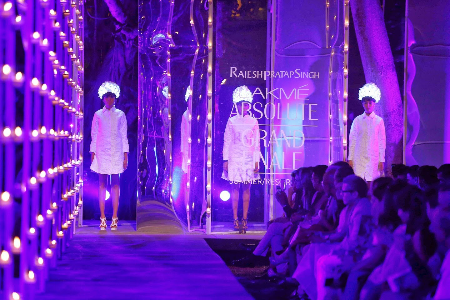 The show opened with models wearing lit helmets with transparent graphic footwear in the iconic white Rajesh Pratap Singh shirts. Soon the pastel palette emerged with skirts, coats, jackets, glittering dresses, blousons; pinafores, coat dresses as well as shimmering shifts.