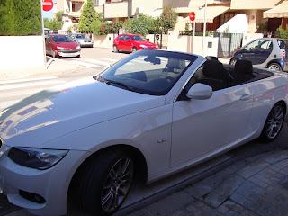 BMW cabriolet White car in the street photo - El saler