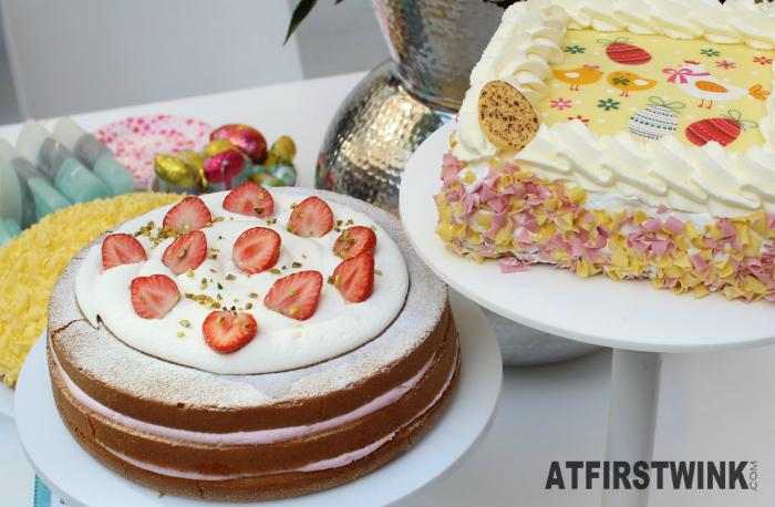 HEMA stacked strawberry-pistachio cake and a yellow, chocolate flake bombe