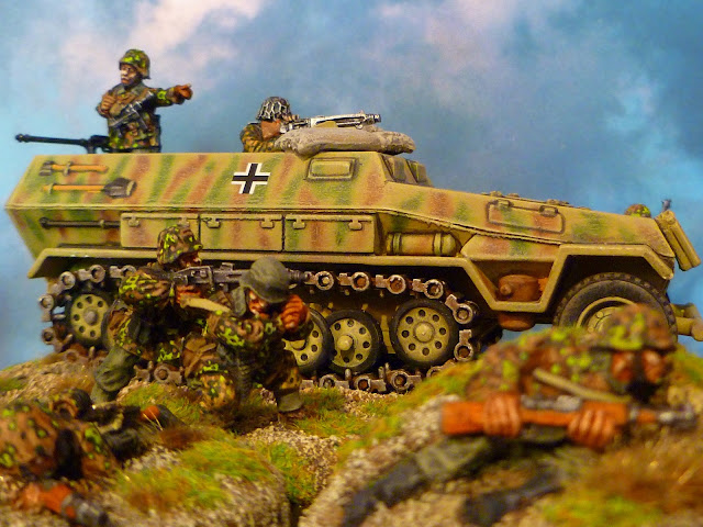 SdKfz 251/1 Ausf B Solido, figurines Warlord Games et Black Tree