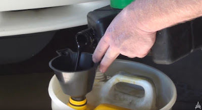 pouring used oil into a sealing bottle