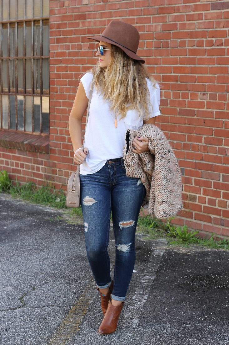 white tee and jeans outfit with boots