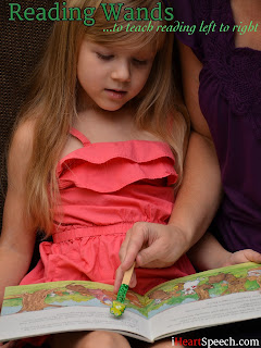 a before kindergarten child reading along with an adult using a Reading Wand