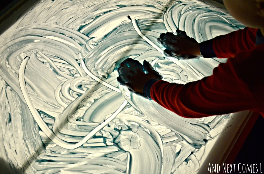 Prewriting messy sensory play on the light table for toddlers and preschoolers from And Next Comes L