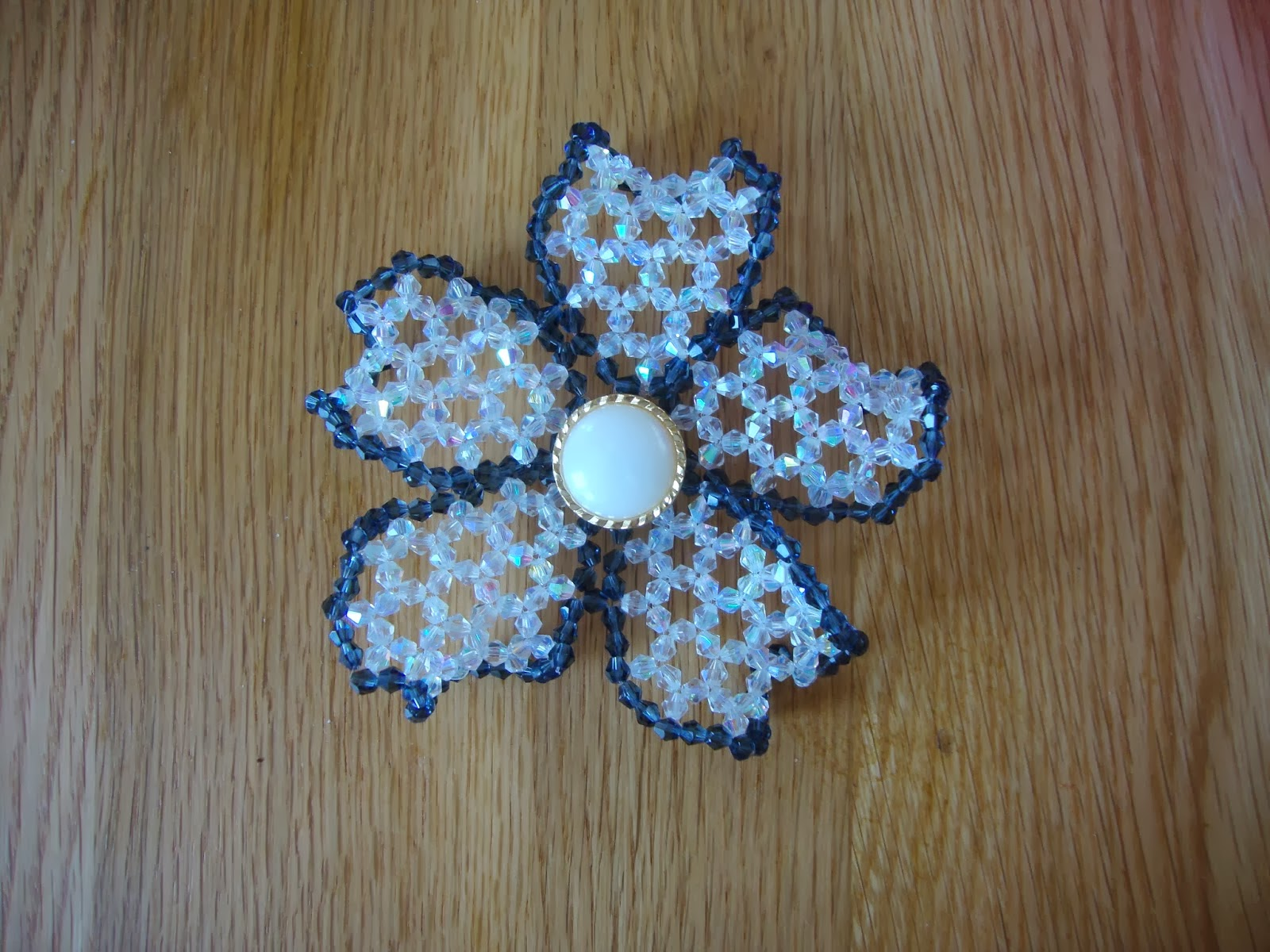 http://strawberrybox-serenie.blogspot.co.uk/2014/03/beaded-flower-brooch.html