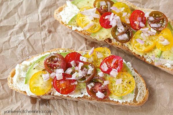 fresh tomato and ricotta summer sandwich with avocado