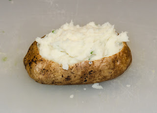 Mashed potato placed back into the baked potato skin