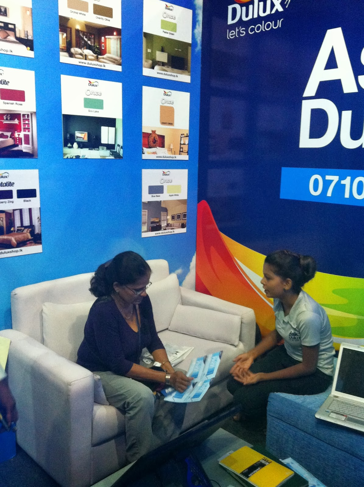 Visitors at the Dulux consultation lounge seek advice on paint choices .