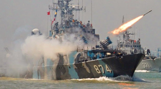Missiles launch from the Naval warship