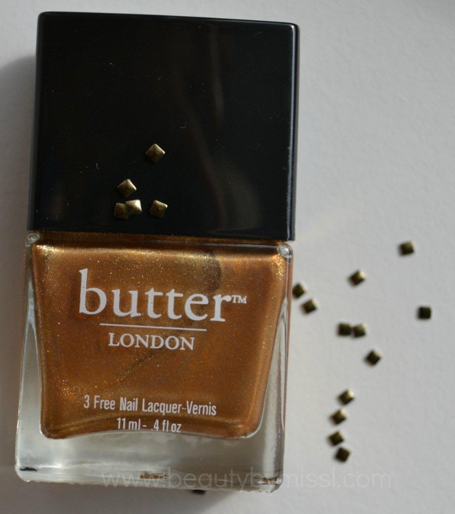 square nail studs, golden nail polish, antique gold