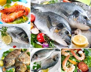 Fotos de pescado cocinado y mariscos con ensaladas
