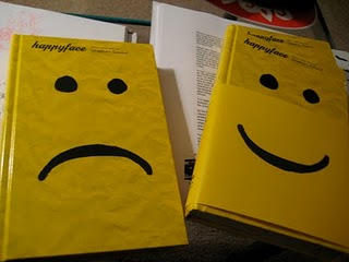 Two copies of the Happyface book