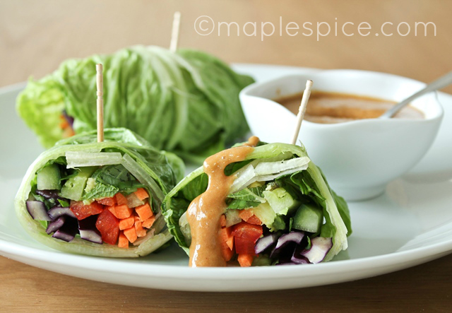 Vegan summer salad rolls with spicy nut butter dip