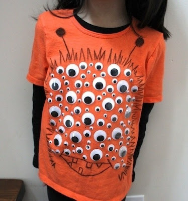 upcycled T-shirt using plastic goggly eyes
