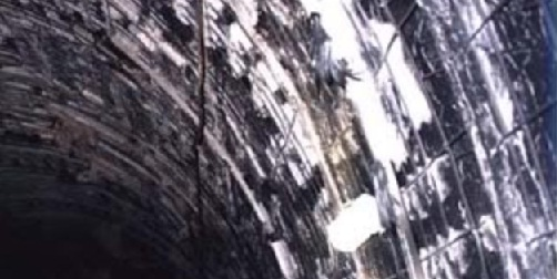 Exposed reinforcement of normal concrete during fire damage in 1996 in Eurotunnel fire