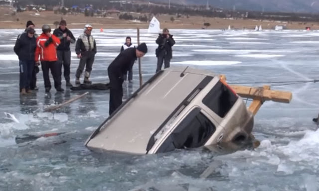 How These Russians Get This Car Out Of A Frozen Lake