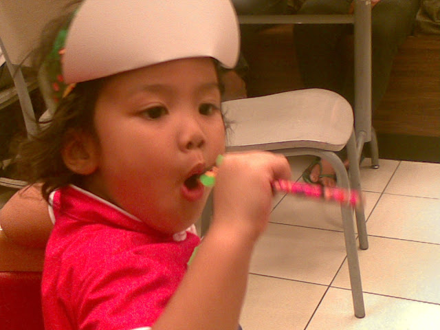 Kecil playing with her Dora pencil