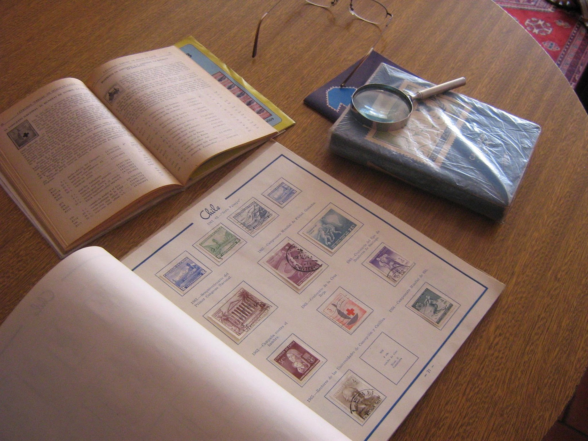 Stamp Collecting Books and Magnifying glass - Enjoy Stamp Collecting? Join the City of Kawartha Lakes Branch free image linked to source