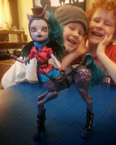 Boys playing with Monster High Freaky Fusion Hybrid Doll Avea Trotter