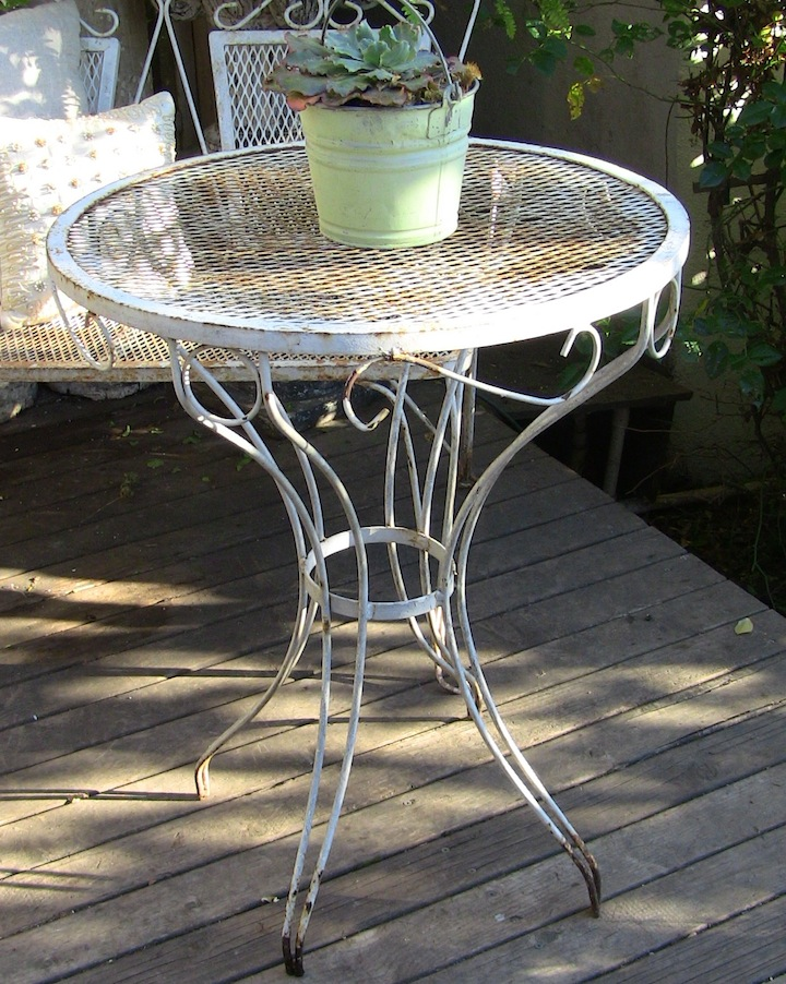 vintage vignettes vintage distressed wrought iron bistro table